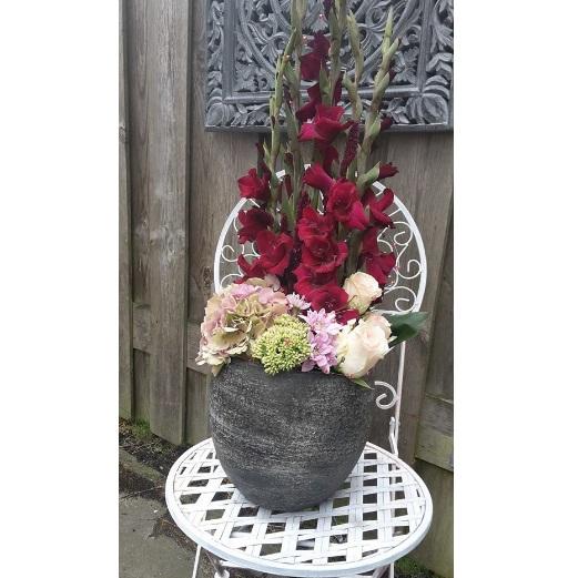 Baliearrangement bloemsoort grote en prijs in overleg .