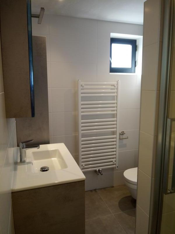 naar een nieuwe badkamer met inloop douche